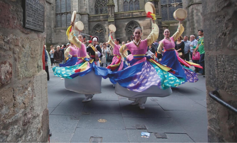 Dancers on the Royal Mile at the Edinburgh Festival Fringe .