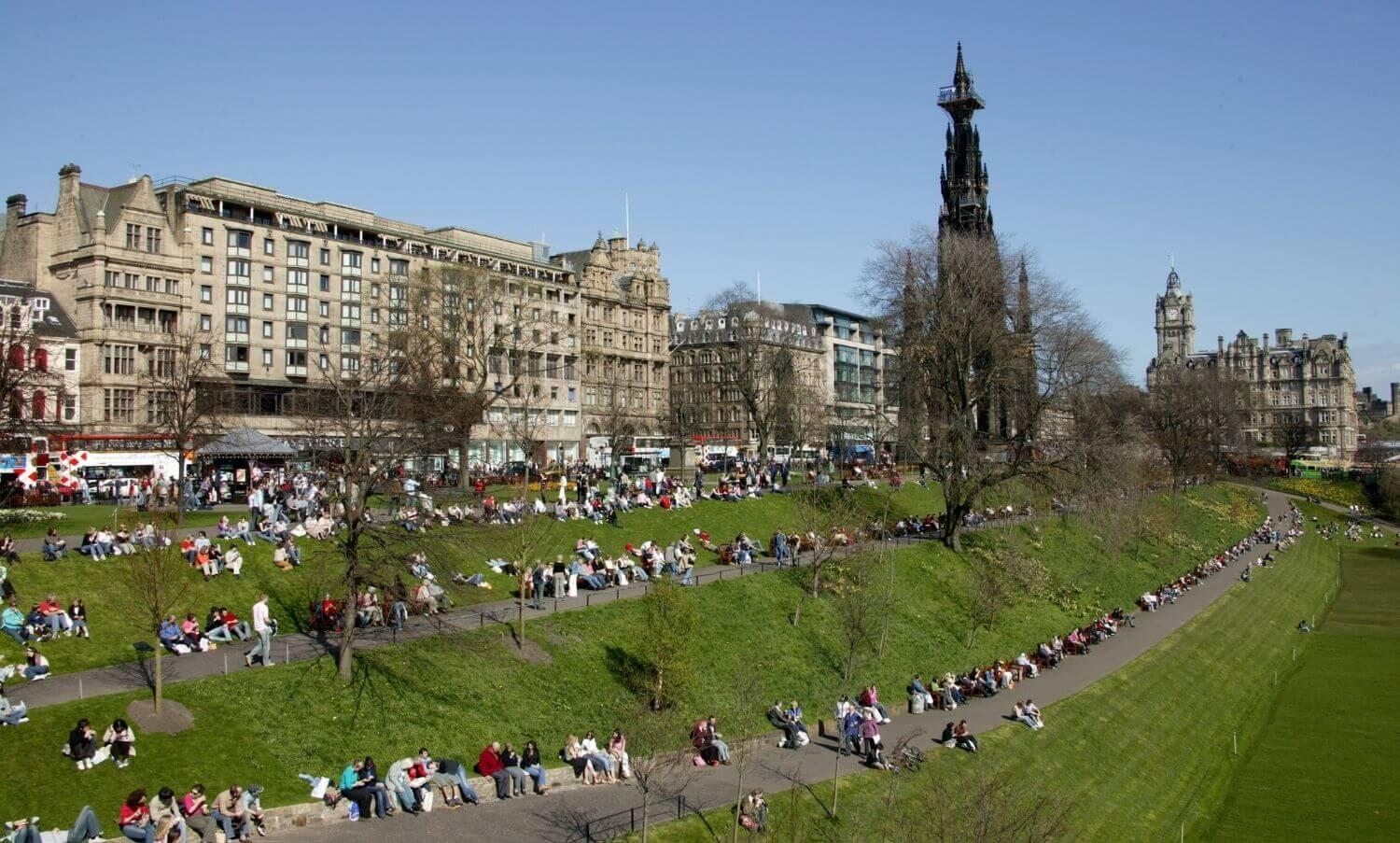 People sitting in the sun in East Princes Street Gardens.