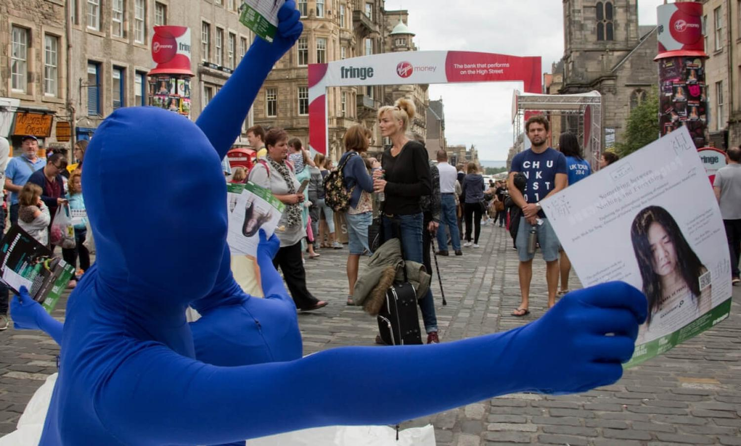 Performers handing out leaflets at Edinburgh Fringe Festival, Royal Mile