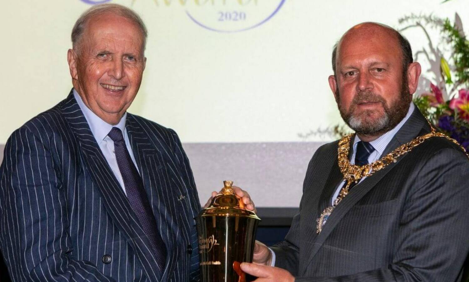 Alexander McCall Smith holding the Edinburgh Award Loving Cup with Lord Provost Frank Ross