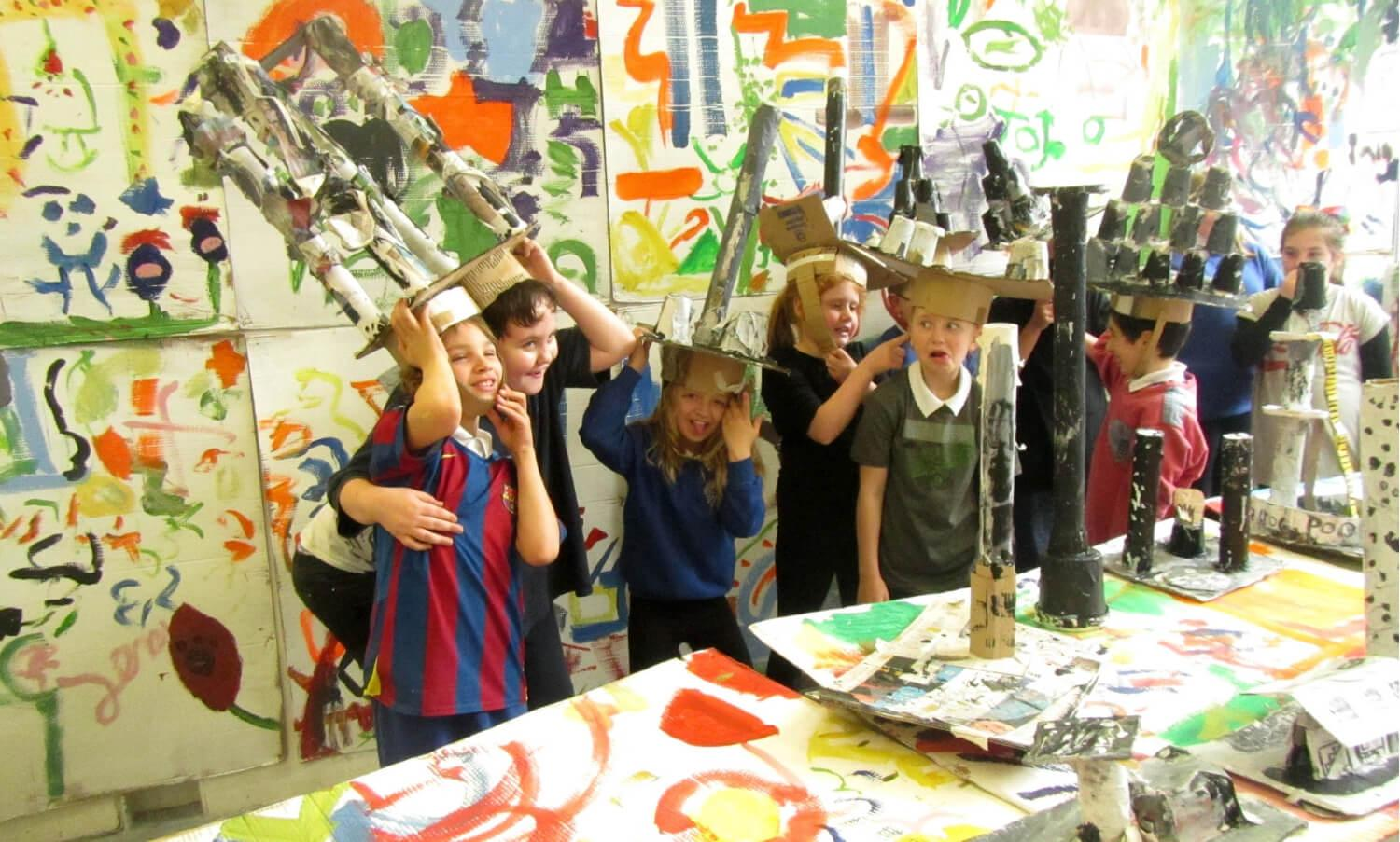School children at Edinburgh Sculpture Work displaying headwear creations that they have made. Image by: Jedrzej Cichosz
