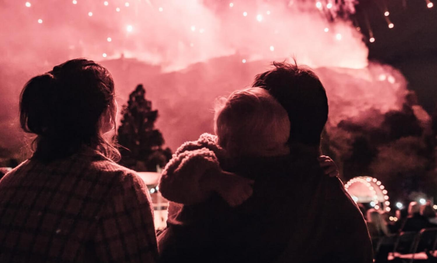 Parents and child at the festival fireworks concert in Princes Street Gardens