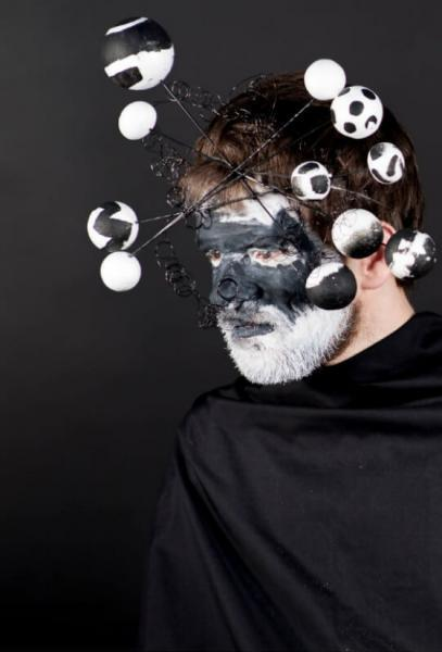 Artlink.  Man with black and white painted face.  Image by: Albie Clark for Artlink.